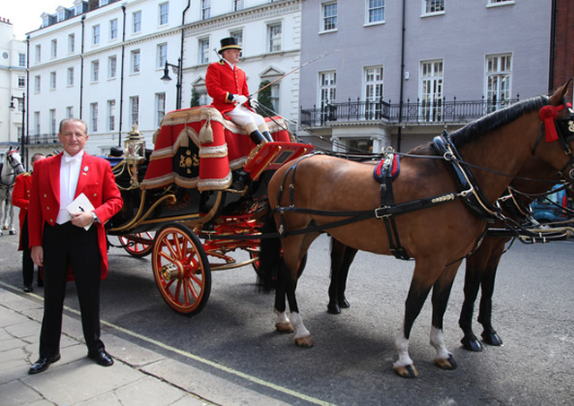 With Royal Carriage